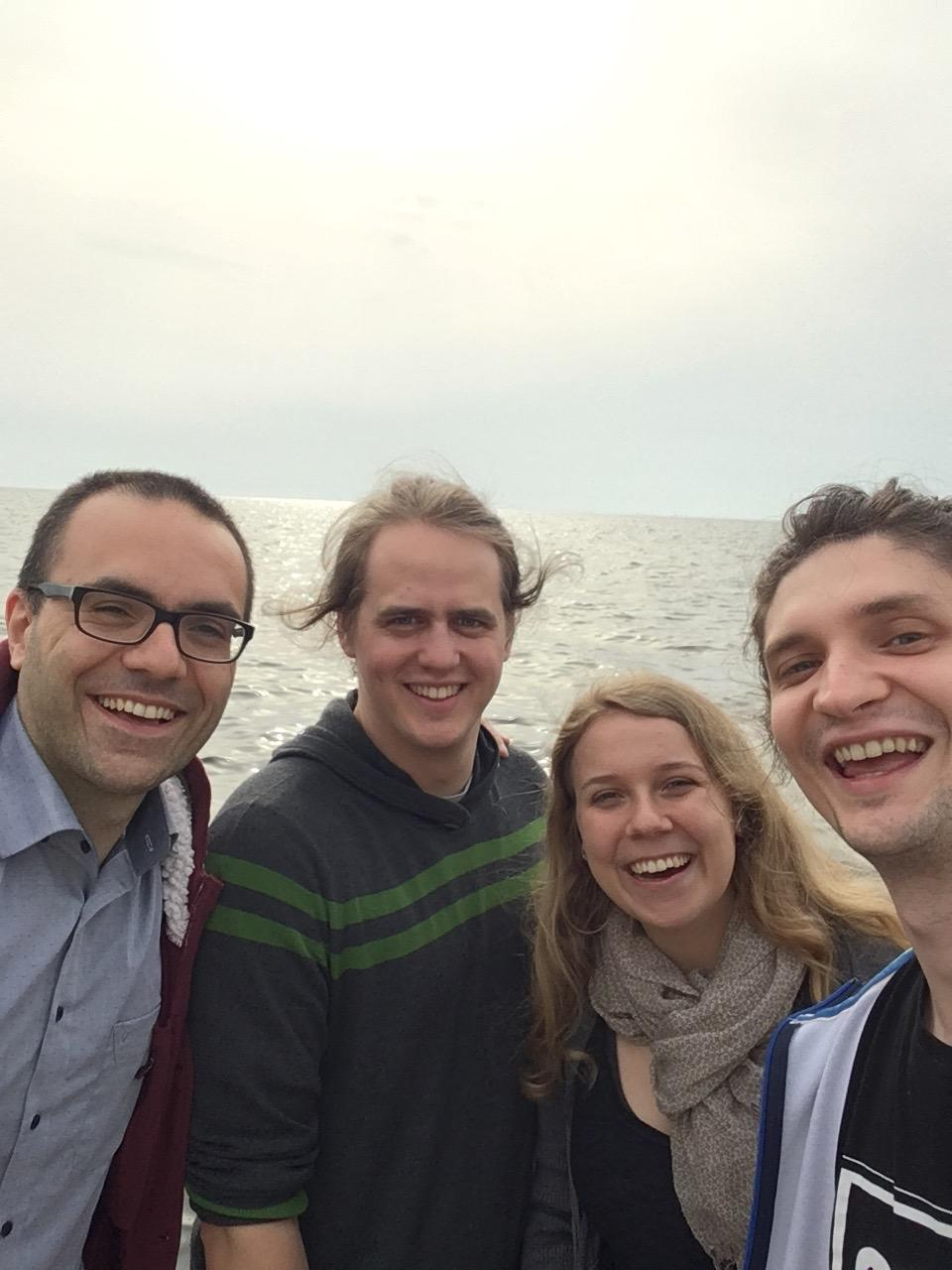 The EtherTrust-Team (Matteo, Niklas, Clara, Ilya) at the sea inThessaloniki