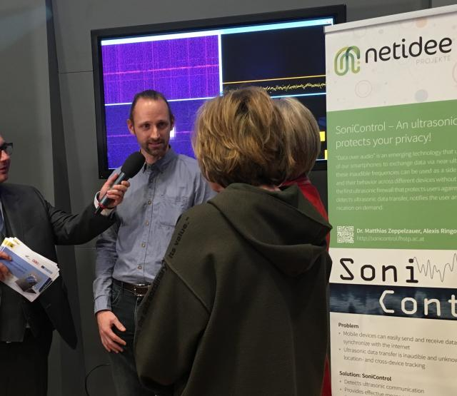 Discussion at SoniControl booth